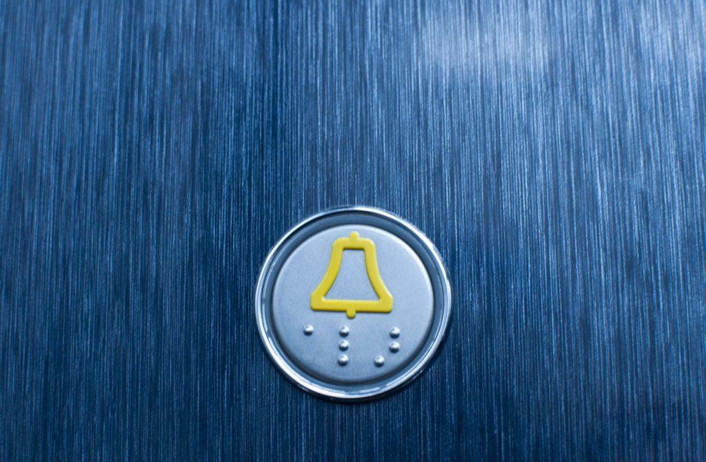 Bild eines Aufzugssicherheitsknopfes